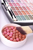 Cosmetic brushes brush , eye shadows and rouge on white backg — Stock Photo