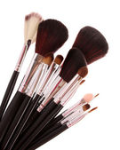 Cosmetic brushes on white — Stock Photo