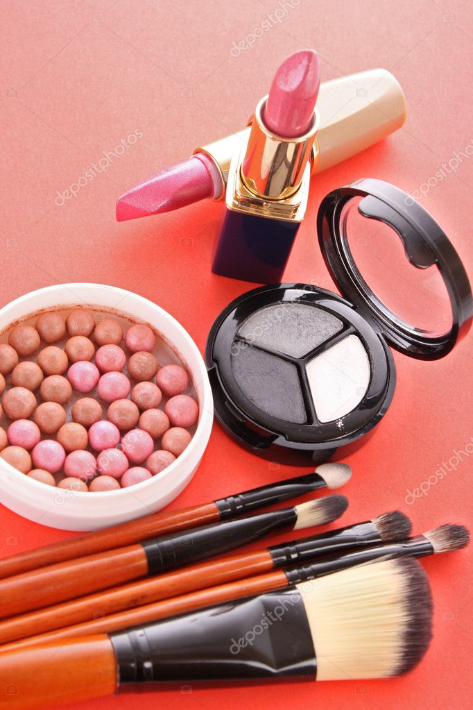 Many  cosmetics  on red background  Stock Photo #6660573