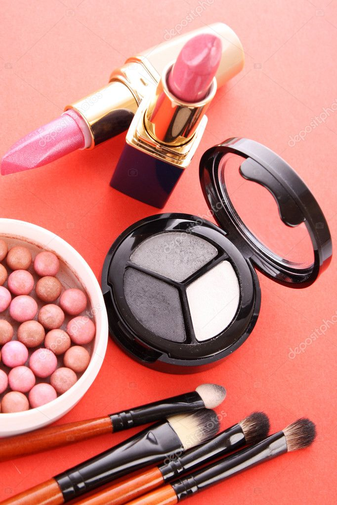 Many cosmetics on red background — Stock Photo #6660578