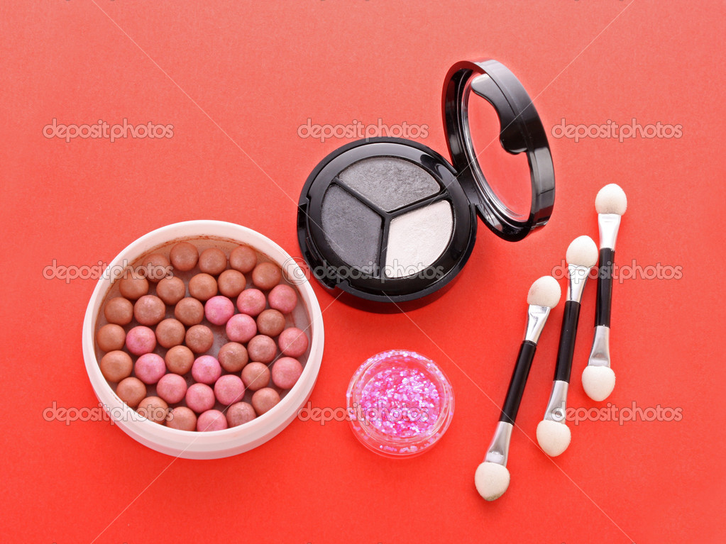 Many  cosmetics  on red background — Stock Photo #6660596