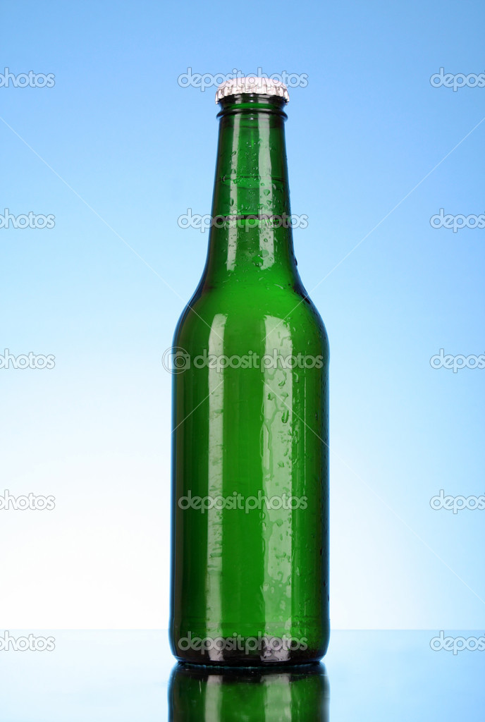 Bottle of beer on blue background — Stock Photo #6660862