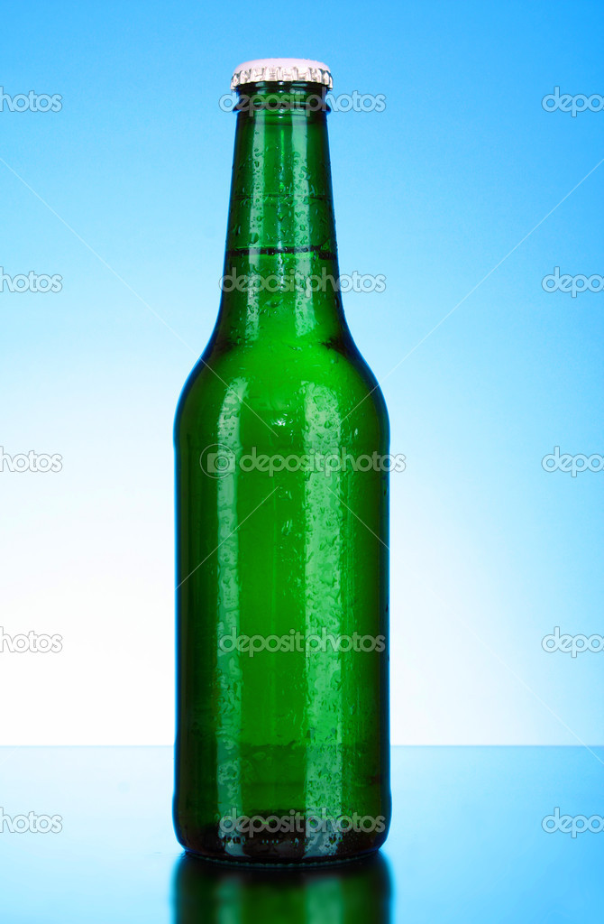 Bottle of beer on blue background — Stock Photo #6660865