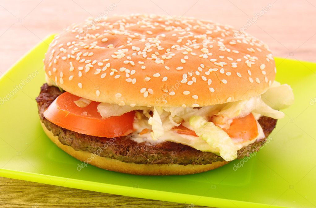 Hamburger with vegetables on the table — Stock Photo #6661163