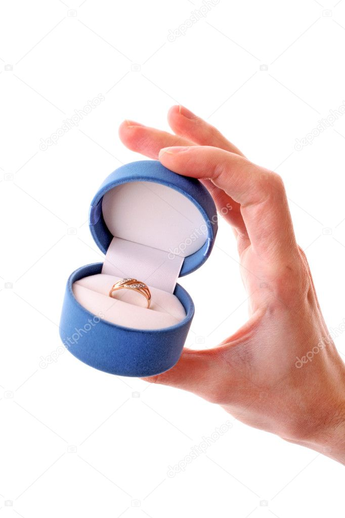 A man  holding up an engagement ring  Stock Photo #6661665