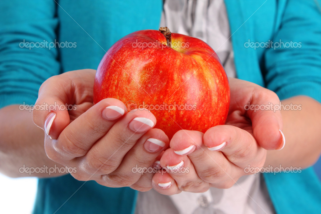 An apple on the hand on blue background — Stock Photo #6667567