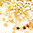 Golden stars in the form of confetti on white — Stock Photo #6675414