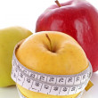 Stock Photo: Red, green and yellow apples measured meter