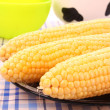 Tasty boiled yellow corn on the table — Stock Photo