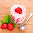 Royalty-Free Stock Photo: Yogurt and strawberry on a wooden background