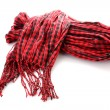 Winter warm red scarf over white - Stock Photo