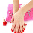 Two hands with the red manicure, isolated - Stock Photo