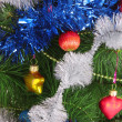 Stock Photo: Christmas toy on a branch of a fur-tree