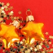 Golden stars in the form of confetti and christmas toys — Stock Photo