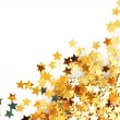 Golden stars in the form of confetti on white — Stock Photo #6676177