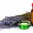 Lavender and oil in bottle isolated on white — Stock Photo