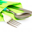 Knife, fork and spoon in green cloth, isolated on white — Stock Photo #6677078