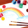 Children drawing of a rainbow on a paper — Stock Photo #6677323
