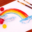 Children drawing of a rainbow on a paper — Stock Photo