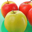 Juicy red apple on green — Stock Photo