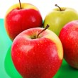 Juicy red apple on green — Stock Photo #6677802