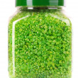 Green aromatic bath salt in bottle isolated on white — Stock Photo