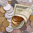 Horn from dollar denominations with coins - Stock Photo