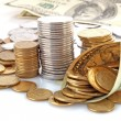 Horn from dollar denominations with coins — Stock Photo