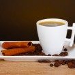 Cup of coffee, coffee beans and cinnamon — Stock Photo