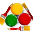 Open tin cans with paint and brushes — Stockfoto