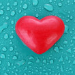 Soap in heart shape on blue water drops background — Stock Photo