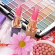 Many colourful woman cosmetics with flower on white white back — Stock Photo #6679544