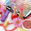 Many colourful woman cosmetics with flower on white white back — Stock Photo