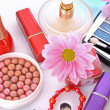 Many colourful woman cosmetics with flower on white white back — Stock Photo #6679550