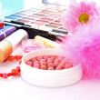 Stock Photo: Rouge on cosmetics background