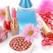 Many colourful woman cosmetics with flower on white white back — Stock Photo #6679585