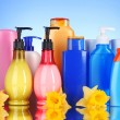 Stock Photo: Bottles of health and beauty products on blue background with re