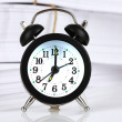 Black alarm clock and documents — Stockfoto