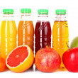 Royalty-Free Stock Photo: Bottles of juice  with ripe fruits on white background