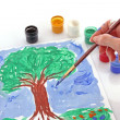 Opened paint buckets colors and drawing tree — Stock fotografie