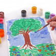Opened paint buckets colors and drawing tree — Stock Photo