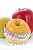 Red, green and yellow apples measured the meter — Stock Photo