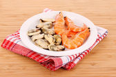 Cooked shelled tiger shrimp and mussels on the table — Stock Photo