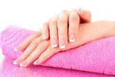 Beautiful woman hands with french manicure on pink background — Stock Photo