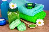 Bath salt, soap and towel on blue background — Stock Photo