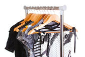 Different clothes on wooden hangers — Stock Photo