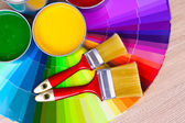 Open tin cans with paint and palette — Stock Photo