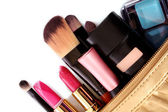 Cosmetics bag with cosmetic on white — Stock Photo
