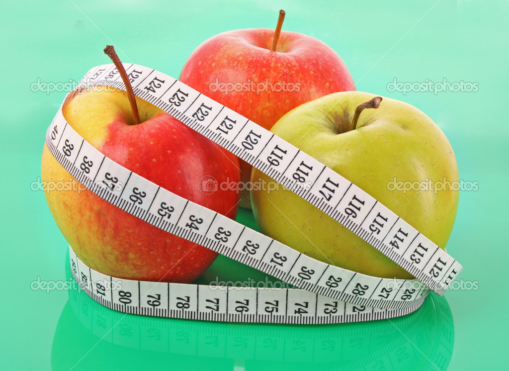 White tape measure around a red apple representing dieting — Stock Photo #6677784