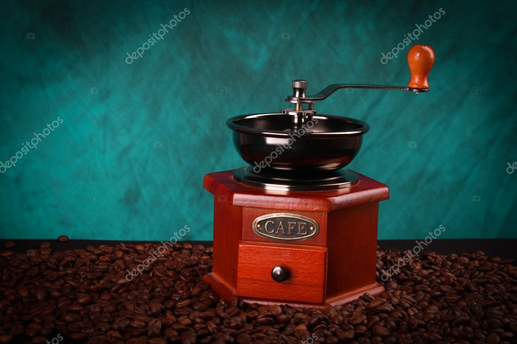 Old coffee Grinder on blue — Stock Photo #6679933